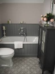 sally s traditional bathroom is a combination of light and dark bathroom grey panelling against bath and we have scrapped the roll top bath idea old style rain shower over bath