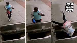 texting lady tumbles through open sidewalk doors new york post