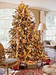 and gold ribbon cascade the tree and multicolored