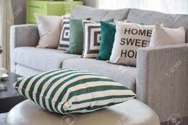 Living Room Pillows by Green Striped Pillows On The Cozy Grey Sofa In The Living Room