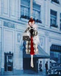 with white feathers ornament by de carlini at