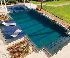 pool with shallow lounge chairs submersed in water pool