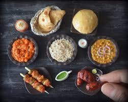 the artist sculpting miniature burgers dosas and nutella jars