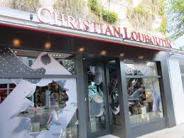 golden chain christian louboutin miami store address