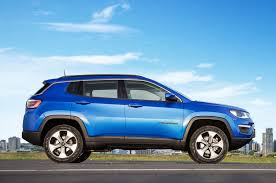 jeep suv blue updated jeep reveals all new compass at plant opening in brazil