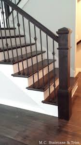 dark wood floors iron stairs what color chandelier and size