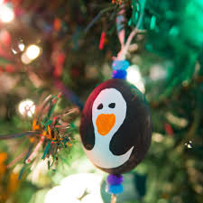 how to make blown egg ornaments painted like penguins
