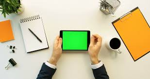 White Office Desks Business Man Using Tablet Device With Green Screen On White Office