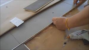 how to install metal transition strip between hardwood flooring