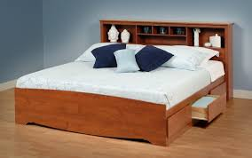 king size light brown lacquered oak wood bed frame with display