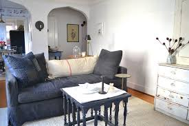 Denim Slipcover Sofa by Denim Slipcover Sofa With Extendable Wall Light Family Room