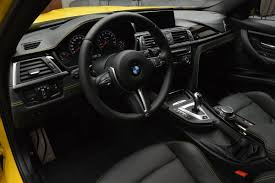 bmw inside 2014 bmw m3 in individual speed yellow races into abu dhabi