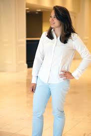 white button down blouse and light blue dress pants skirt the