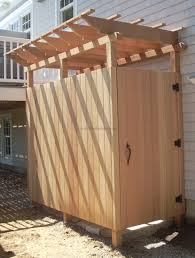 tasteful pine wooden half screen outside shower with pergola roofs