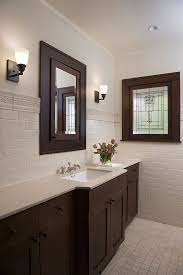 brushed nickel mirror bathroom victorian with white countertop