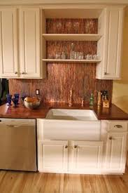 copper backsplash kitchen decor inspiration warm metallics copper pots kitchen