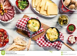 Cold Dinner Delicious Restaurant Dinner With Swiss Raclette Stock Photo
