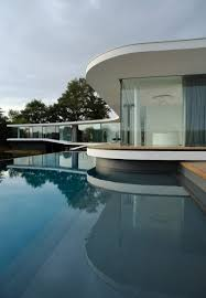 Col House by Aum U0027s White Snake House Is A Curving Concrete And Glass Residence