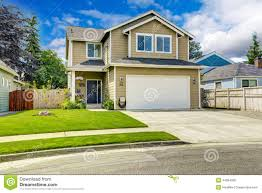 two story house exterior with front yard landscape stock image