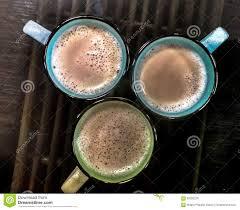 coffee mugs on cane table stock photo image 68382278