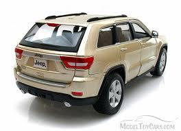 jeep cherokee toy jeep grand cherokee laredo suv gold maisto 31205 1 24 scale