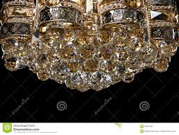 large chandelier close up in baroque style isolated on