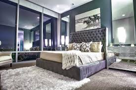 mirrored dresser in bedroom contemporary with tufted headboard