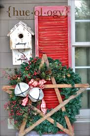 rustic christmas porch display hueology wreath by olde tyme