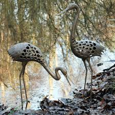 pair of heron metal sculptures metal garden ornaments
