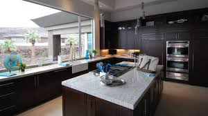 black kitchen cabinets with marble countertops contemporary kitchen with wood cabinets and white