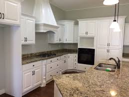 knotty alder kitchen cabinets and range after being refinished
