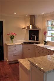 kitchen designs and more diagonal cooktop chimney hood tiled niche kitchen design