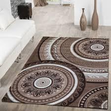 versace wohnzimmer teppich wohnzimmer kreise ornamente versace design gepunktet braun