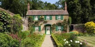 the english cottage decor of the day english cottage with green shutters scene
