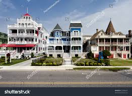 colorful victorian style houses alongside road stock photo