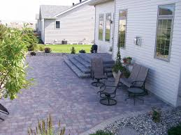 Backyard Paver Patio by Raised Paver Patio With Retaining Walls Stairs Deck And Seating