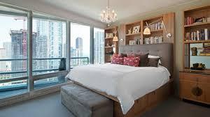 bedroom crystal chandelier wooden bed frame upholstered bedroom