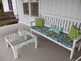 exterior white wooden bench with green treliss pattern cushion