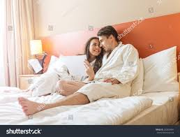 Young Couple Room Young Couple Lying Bed Hotel Room Stock Photo 203829094 Shutterstock