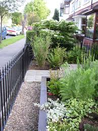 small garden ideas to make the most of a tiny space tall hedge
