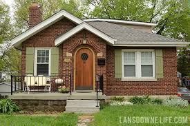 curb appeal adding board and batten cottage style shutters