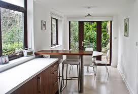 walnut breakfast bar table bespoke kitchen in walnut by bristol fine furniture
