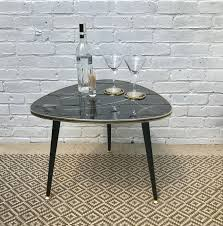 triangle shaped coffee table a triangular shaped coffee table with decorative retro top and gold
