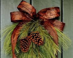 simply winter pine cone and ribbon swag wreath