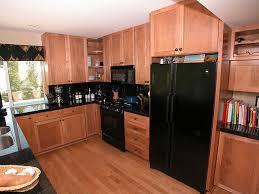 kitchen appliance ideas lately white kitchens with black appliances via