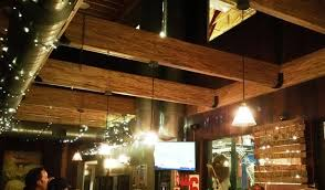 lighting on exposed beams exposed beams and twinkle lights picture of logboat brewing