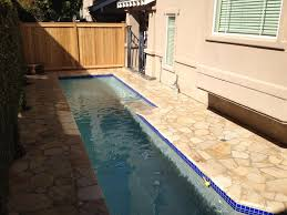 very fetching backyard pool design ideas with blue tiles also