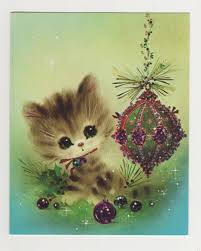 vintage 1970s cute cat or kitten with big eyes and glitter