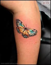 bright simple butterfly on arm tattoomagz