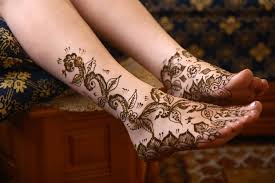 classic henna flower tattoo on feet